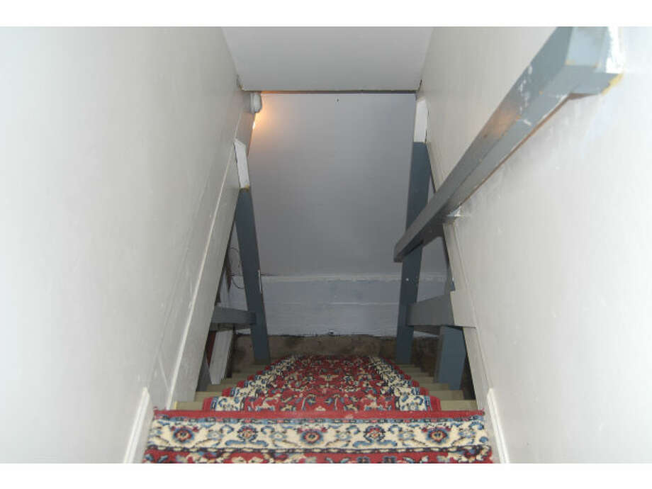 Scary down the stairs pic. Photos via MLS/Amy Lui, Alain Pinel Realtors