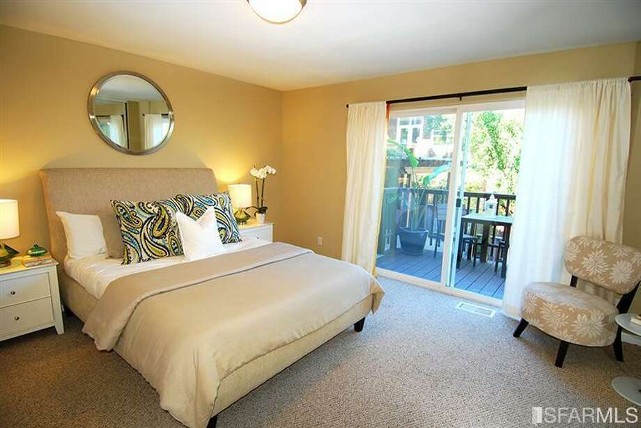 One of the beds. Photos via MLS/Nina Geneson, Metropolitan Properties