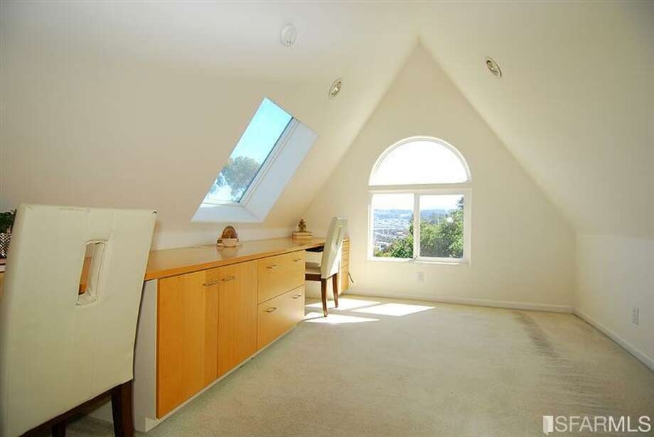 Attic/office. Photos via MLS/Nina Geneson, Metropolitan Properties