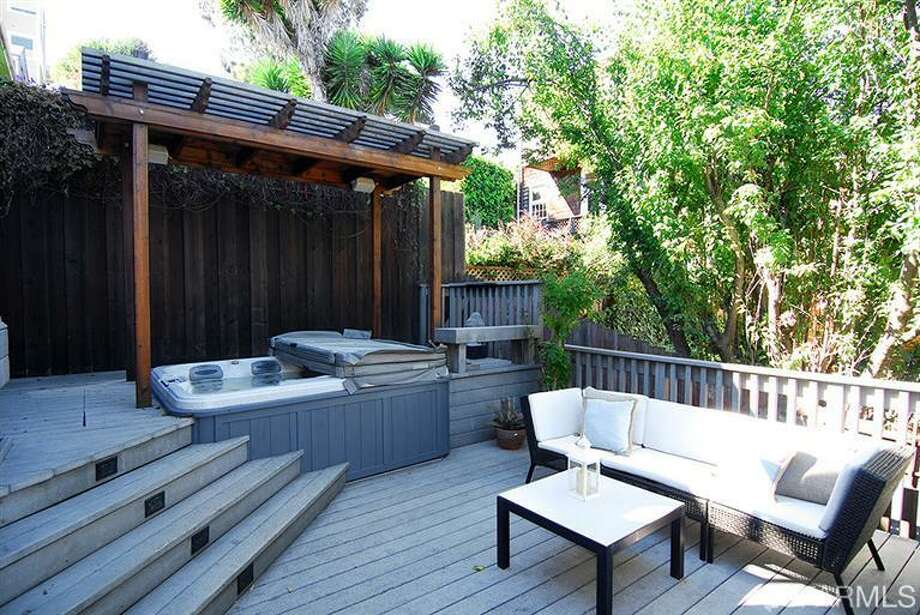 Deck with hot tub! Photos via MLS/Nina Geneson, Metropolitan Properties