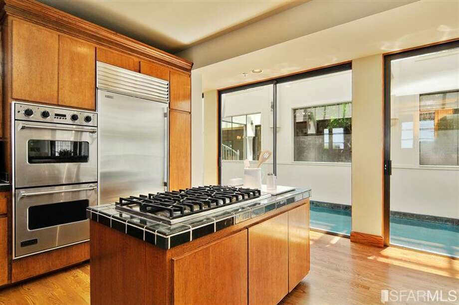 Kitchen again, and yes, that's a lap pool you see in the corner. Photos via MLS/Craig Adams, Coldwell Banker Res. R.E. Svcs