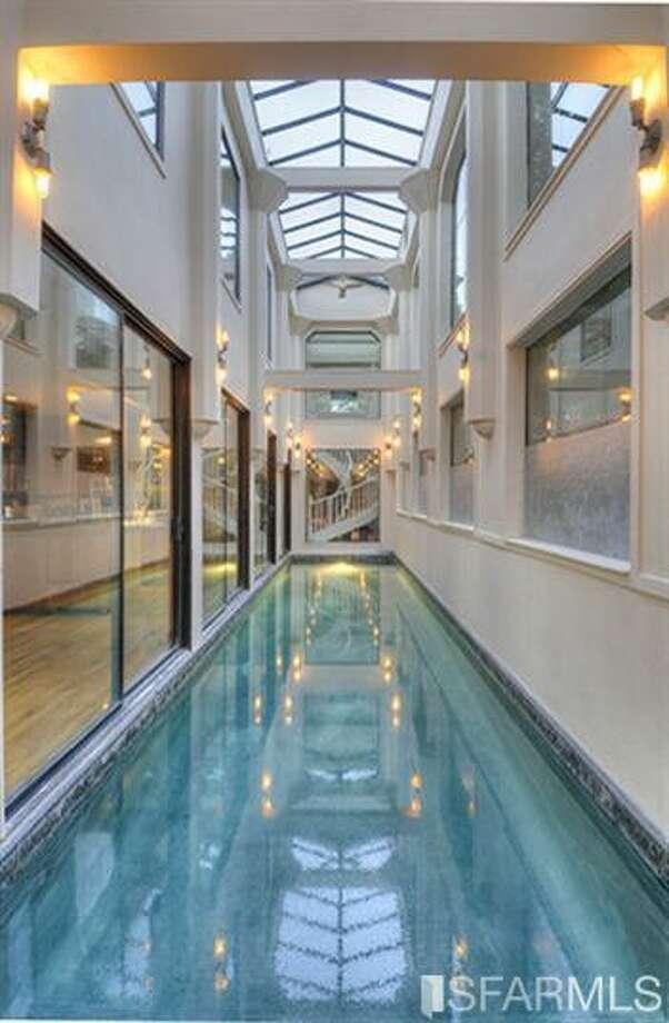 That pool. (!!!) Photos via MLS/Craig Adams, Coldwell Banker Res. R.E. Svcs
