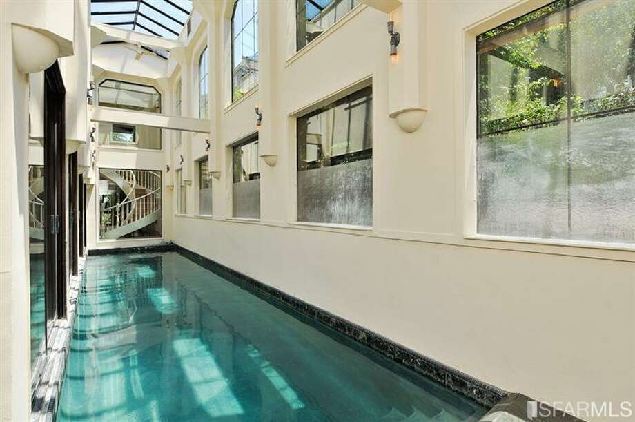 Stairwell and pool view. Photos via MLS/Craig Adams, Coldwell Banker Res. R.E. Svcs