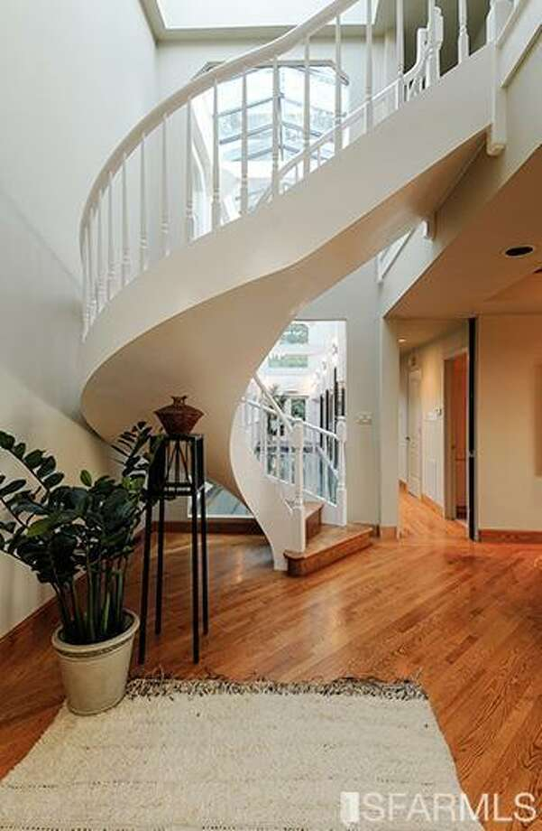 Stairwell. Photos via MLS/Craig Adams, Coldwell Banker Res. R.E. Svcs