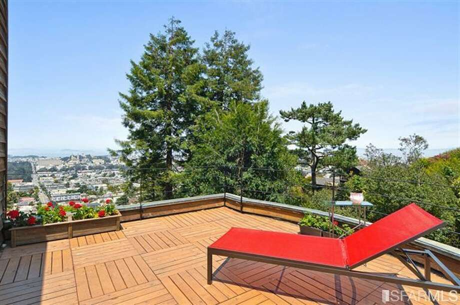 Deck overlooking Clarendon Heights. Photos via MLS/Craig Adams, Coldwell Banker Res. R.E. Svcs