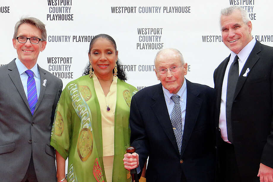 Westport Country Playhouse Artistic Director Mark Lamos, left, and Managing Director Michael Ross, right, flank actress/director Phylicia Rashad and philanthropist Howard J. Aibel, honorees Monday at the theater's annual gala. Photo: Mike Lauterborn / Westport News contributed