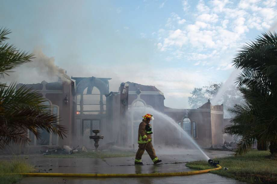 Houston Firefighters respond to a 1 alarm fire that destroyed a house in the Serenity Estates subdivision on Tuesday, Sept. 17, 2013 in Humble. ( Mayra Beltran / Houston Chronicle ) Photo: Mayra Beltran, Houston Chronicle
