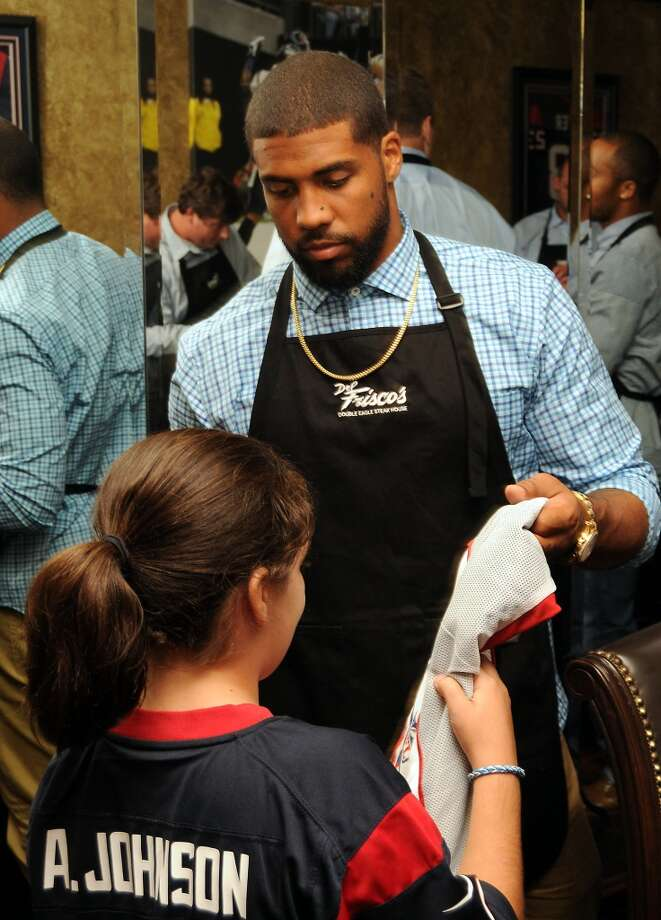 Arian Foster signs an autograph for a fan Photo: Dave Rossman, For The Houston Chronicle