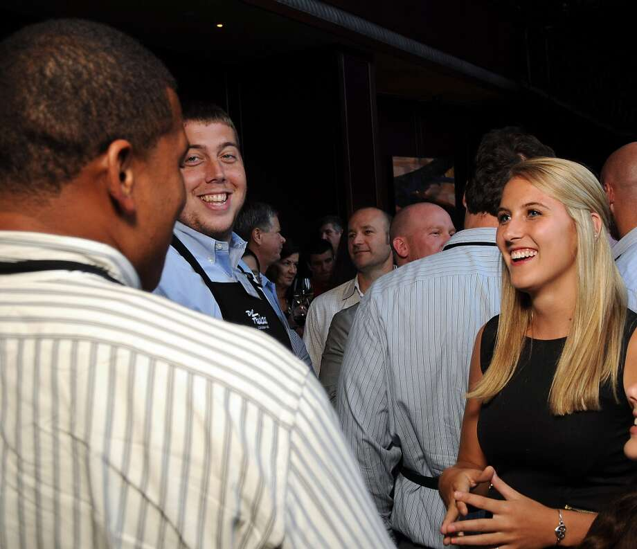 Texan fan Megan Shafer chats with Brandon Brooks and Andrew Gardner Photo: Dave Rossman, For The Houston Chronicle