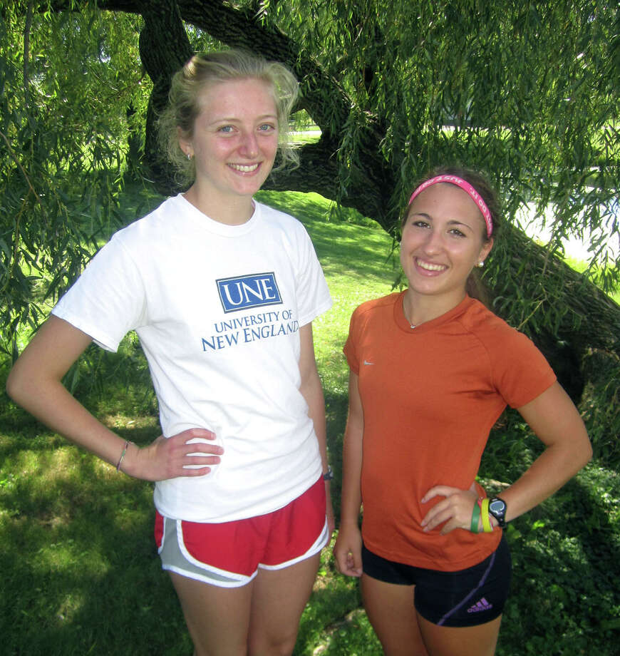 Clara Wolfe, left, and Kelsey Hall bring senior leadership to their roles as captains this fall for Shepaug Valley High School girls' cross coutnry. September 2013 Photo: Norm Cummings