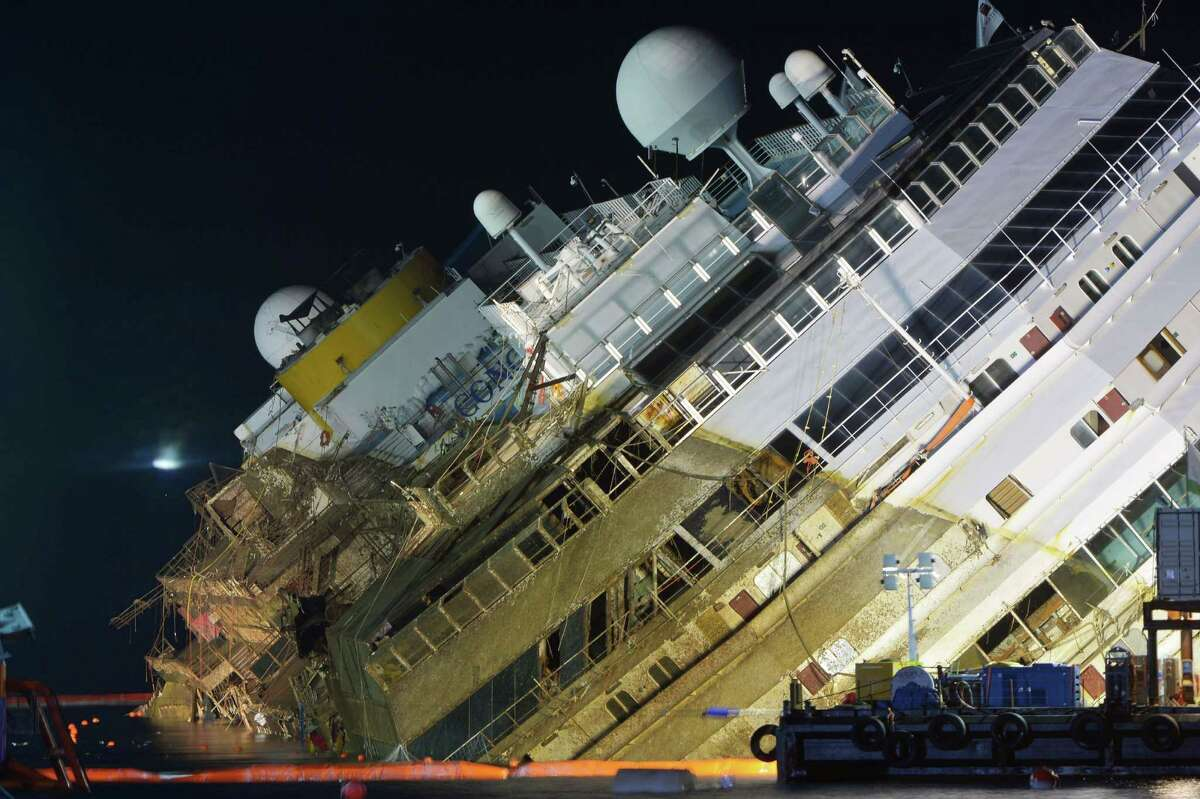 TOPSHOTS The wreck of Italy's Costa Concordia cruise ship begins to emerge from water on September 16, 2013 near the harbour of Giglio Porto. Salvage workers attempt to raise the cruise ship today and tonight, in the largest and most expensive maritime salvage operation in history, so-called