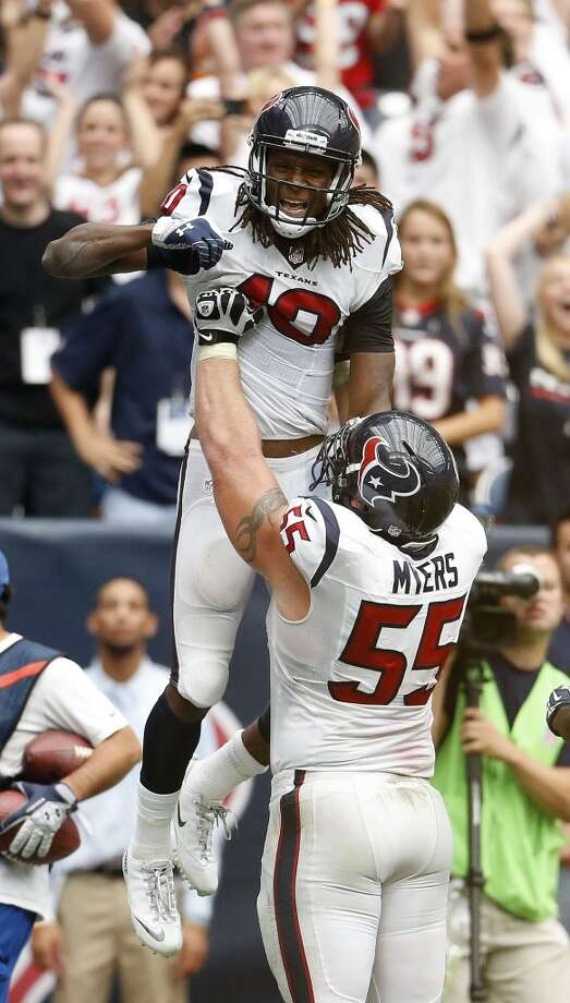 Wide receiver DeAndre Hopkins is lifted up by center Chris Myers after his game-winning touchdown in overtime. Photo: Karen Warren, Houston Chronicle