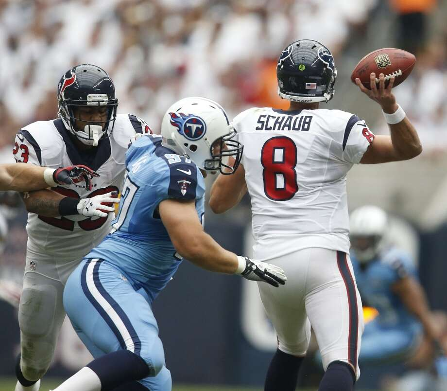 Quarterback Matt Schaub nearly gets sacked by Titans defensive tackle Karl Klug during the third quarter. Photo: Karen Warren, Houston Chronicle