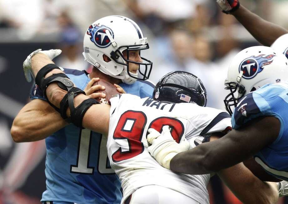 Titans quarterback Jake Locker is sacked by Texans defensive end J.J. Watt during the third quarter. Photo: Brett Coomer, Houston Chronicle