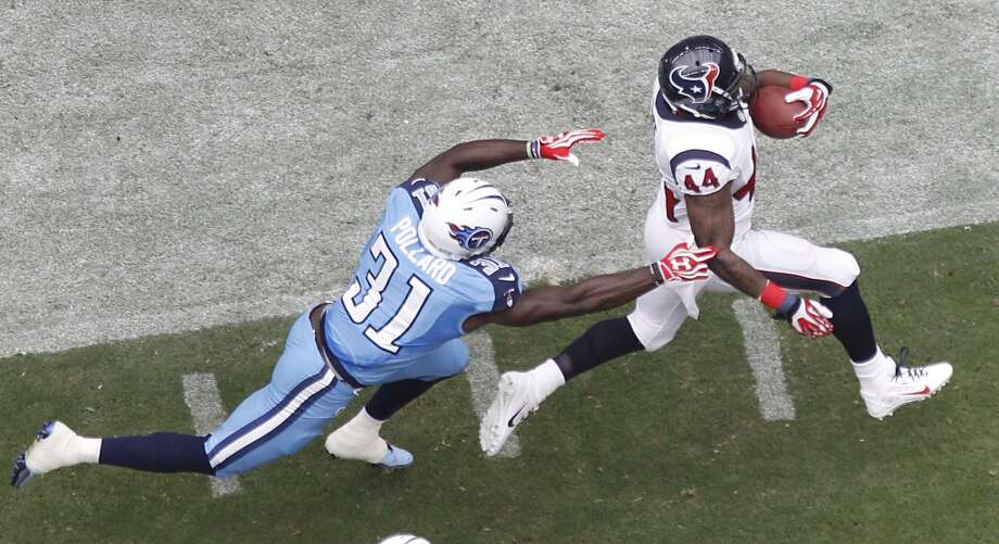 Running back Ben Tate breaks away from Titans strong safety Bernard Pollard for a 60-yard run during the first quarter Photo: Brett Coomer, Houston Chronicle