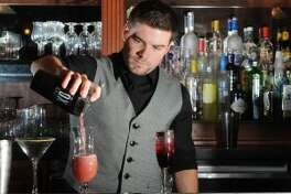 Bartender Max Keen pours a drink at Suga's.Photo taken March 27, 2013. Guiseppe Barranco/cat5