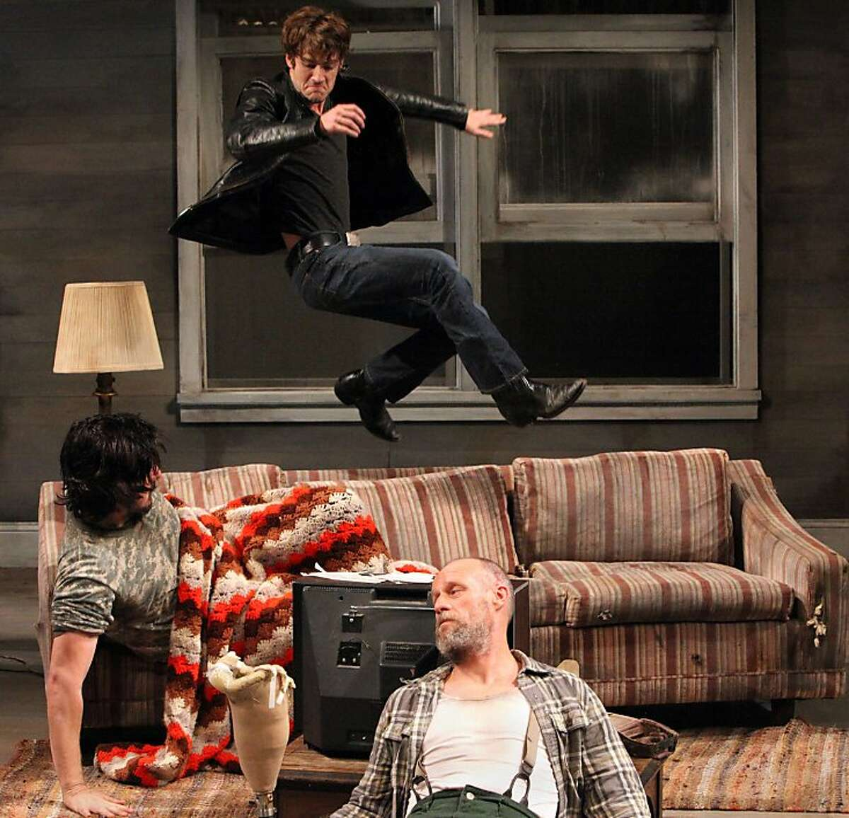 """Vince (Patrick Alparone, above) returns to the old homestead, his uncle Bradley (Patrick Kelly Jones, on couch) and grandfather Dodge (Rod Gnapp) and a homecoming he didnt expect in Sam Shepard's """"Buried Child"""" at Magic Theatre"""