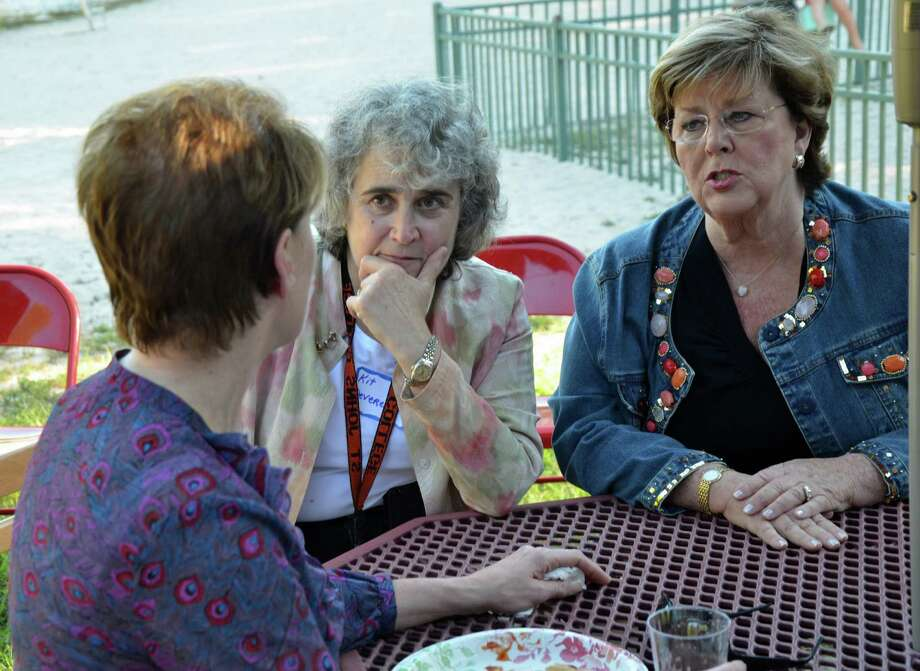 Democratic Town Council candidate Jeanne Rozel speaks with Town Council member Kit Devereaux and Constable candidate Cindy Franco at the New Canaan Democrats' 10th annual barbecue, held in Kiwanis Park. Photo: Contributed Photo