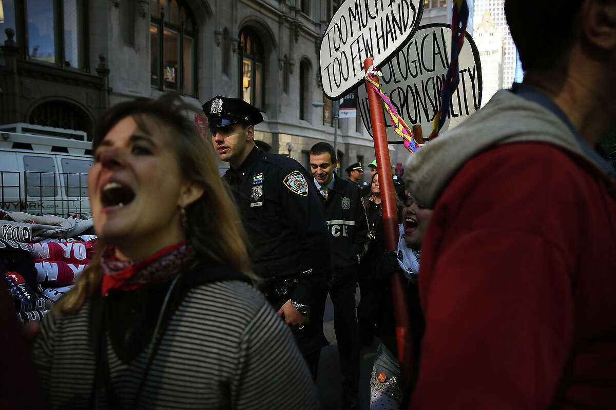 Protesters affiliated with Occupy Wall Street demonstrate for a variety of causes at Zuccotti Park near the New York Stock Exchange on the second anniversary of the movement on September 17, 2013 in New York City. Numerous rallies and events across the city were planned for the movement which takes aim at inequality and financial greed and which has influenced activist moments around the world. While police presence was high in New York, with a helicopter flying above the park, no incidents had been reported by the afternoon.