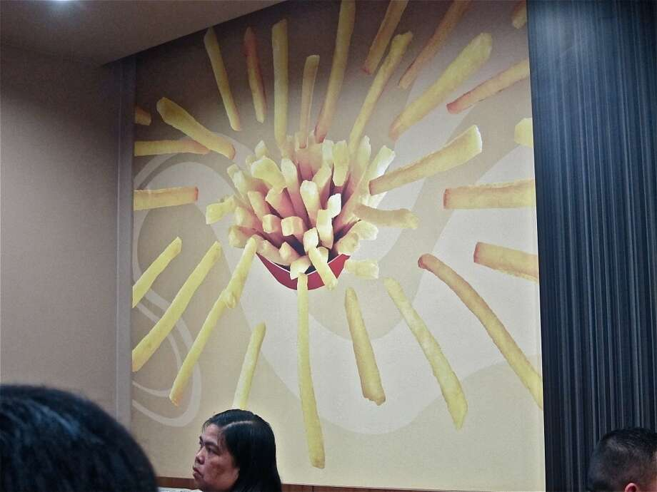 Giant French fry graphic at Jollibee. Photo: Alison Cook