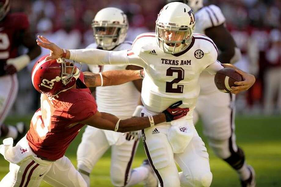 Even Manziel's manic efforts no enough to bring down No. 1 Alabama a second time.