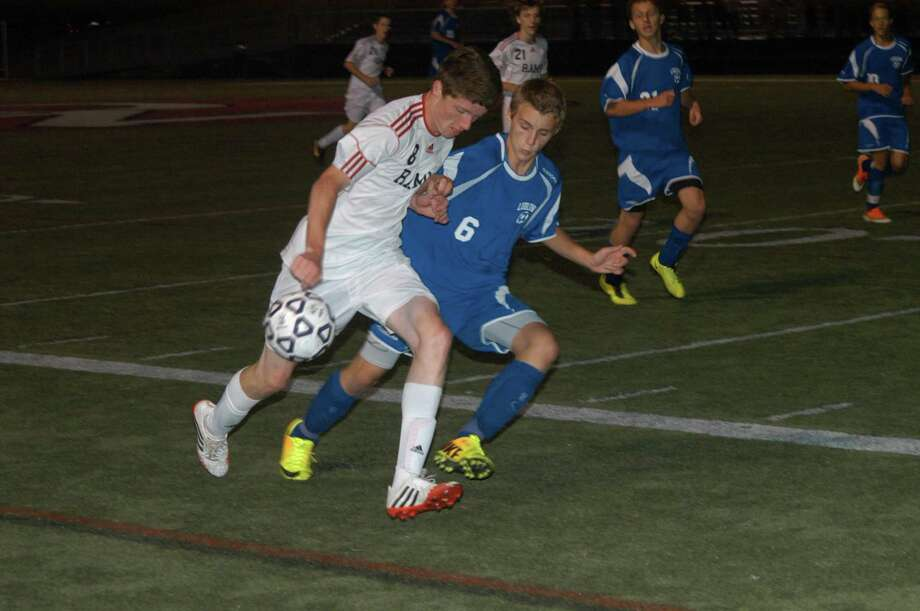 New Canaan's Grant Beck and Fairfield Ludlowe's Richie Bellucci go for the ball during Ludlowe's 1-0 win on Monday, Sept. 16, 2013 at New Canaan High School. By Andy Hutchison Photo: Contributed Photo