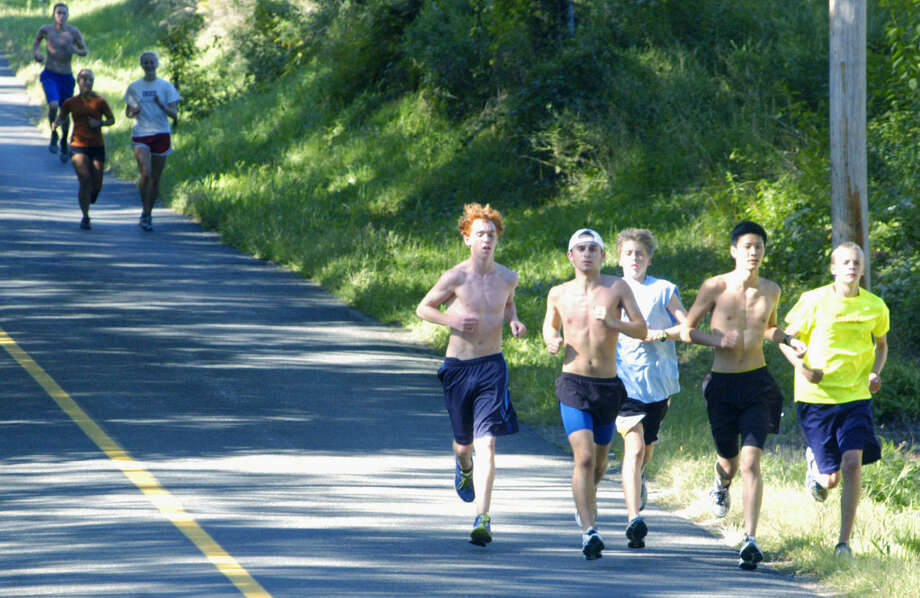 The Spartans cruise Painter Ridge in Roxbury in preparation for the Shepaug Valley High School boys' cross coutnry season. Leading the way are, from left to right, Quinton Walsh, Clayton Firmender, Erik Quist, Nathan Ong and Ed Wolfe. September 2013 Photo: Norm Cummings