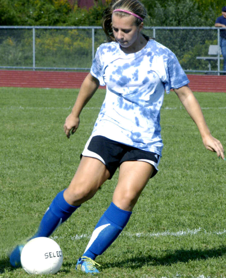 The Spartans' Sarah Stratton shows off her effective scoring touch for Shepaug Valley High School girls' soccer. September 2013 Photo: Norm Cummings