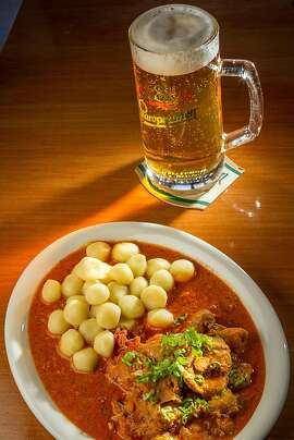 The Chicken Paprikash with a Staropramen lager at Paprika restaurant in San Francisco , Calif., is seen on Friday, September 6th, 2013.