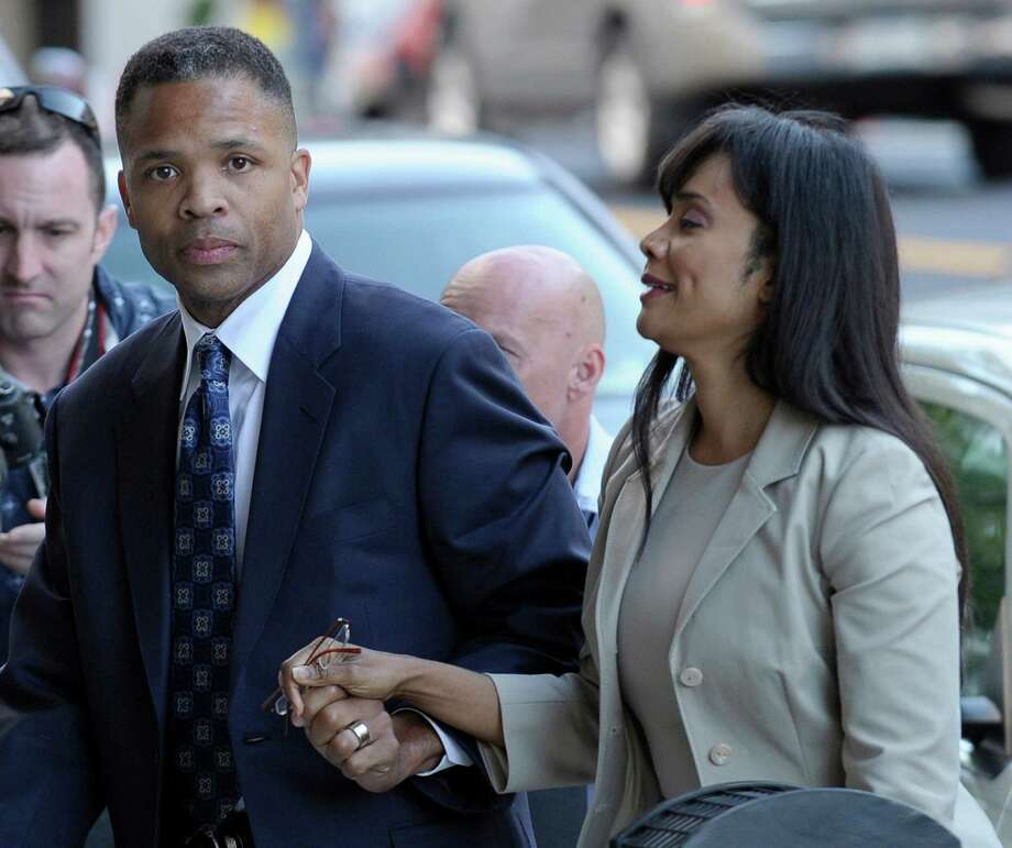 FILE - In this Wednesday, Aug. 14, 2013, file photo, former Illinois Rep. Jesse Jackson Jr. and his wife, Sandra, arrive at federal court in Washington,  to learn their fates when a federal judge sentences the one-time power couple for misusing $750,000 in campaign money on everything from a gold-plated Rolex watch and mink capes to vacations and mounted elk heads. Jesse Jackson Jr.'s posessions _ including fur capes and Michael Jackson memorabilia _ go on the auction block Tuesday, Sept. 17, 2013, in an attempt to generate cash to pay his $750,000 fine for fundraising violations. (AP Photo/Susan Walsh, File) ORG XMIT: NY108 Photo: Susan Walsh / AP