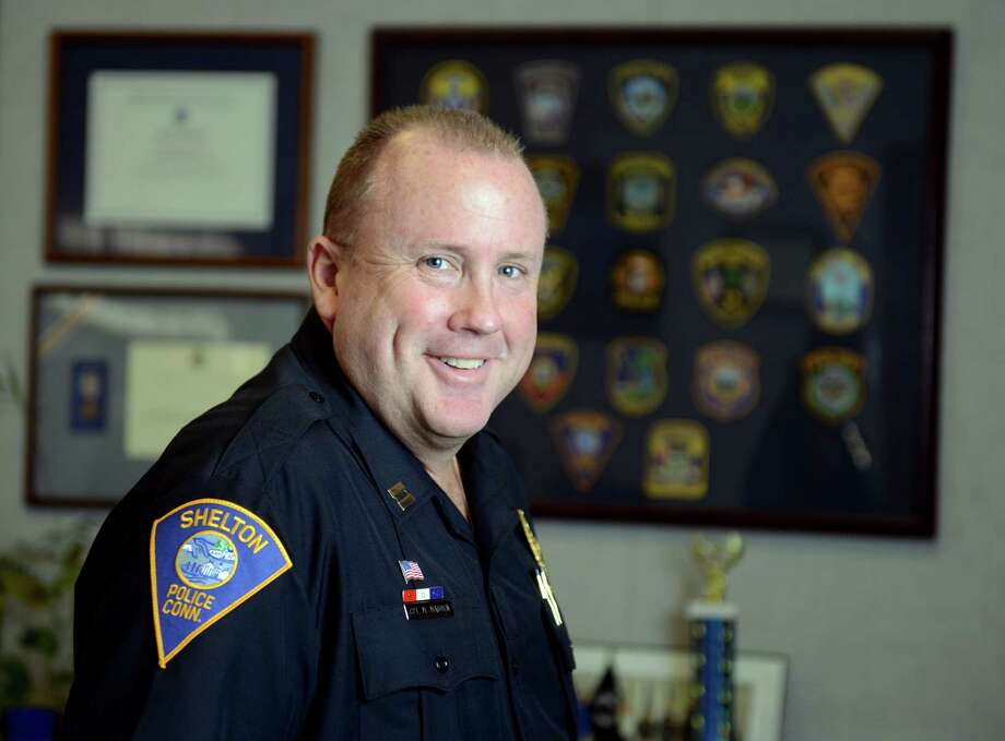 Shelton Police Dept. Captain Michael P. Madden is retiring after 27 years. He'll be the new police chief in Paris, Maine. Photo: Autumn Driscoll / Connecticut Post