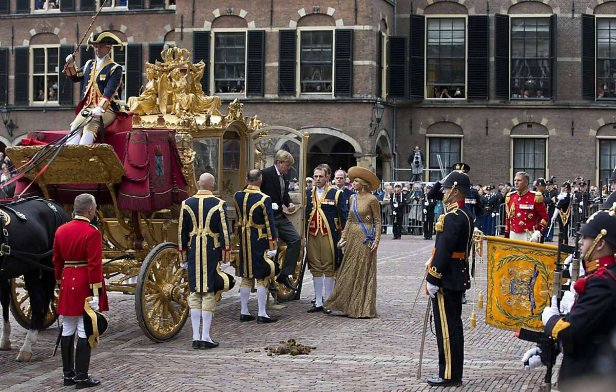 Watch your step, Your Highness. The royal carriage had an accident: King Willem-Alexander and his wife Queen Maxima arrive at the Hall of Knights for the official opening of the new parliamentary year in The Hague, Netherlands.