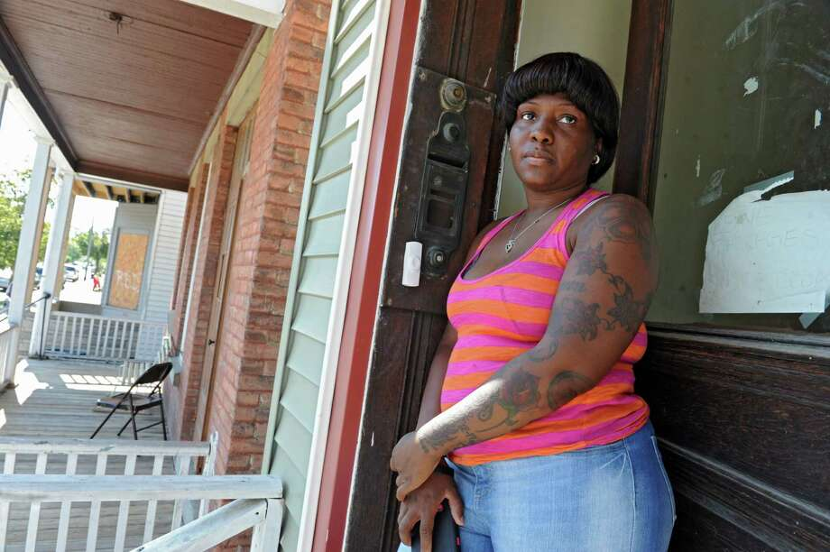 Rose Kelliebrew stands in her front door at 151 Fifth Ave. on Tuesday, Sept. 17, 2013 in Lansingburgh, N.Y. Her window was shot at at least four times in a drive by shooting last night.  (Lori Van Buren / Times Union) Photo: Lori Van Buren / 00023897A