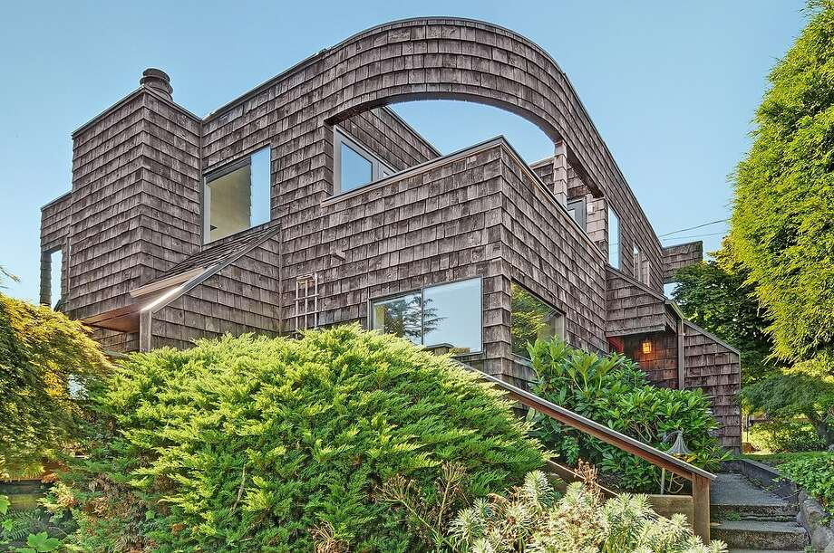 Beacon Hill features a range of home styles for reasonable prices, by Seattle standards. Here are several listed for $399,000 to $450,000, starting with 2815 S Dawson St. The 1,970-square-foot modern house, built in 1953, has three bedrooms, two bathrooms, multiple decks and patios, and views of Lake Washington and the Cascade Mountains on a 4,680-square-foot lot. It's listed for $434,000. Photo: Courtesy Matt Martel, Findwell