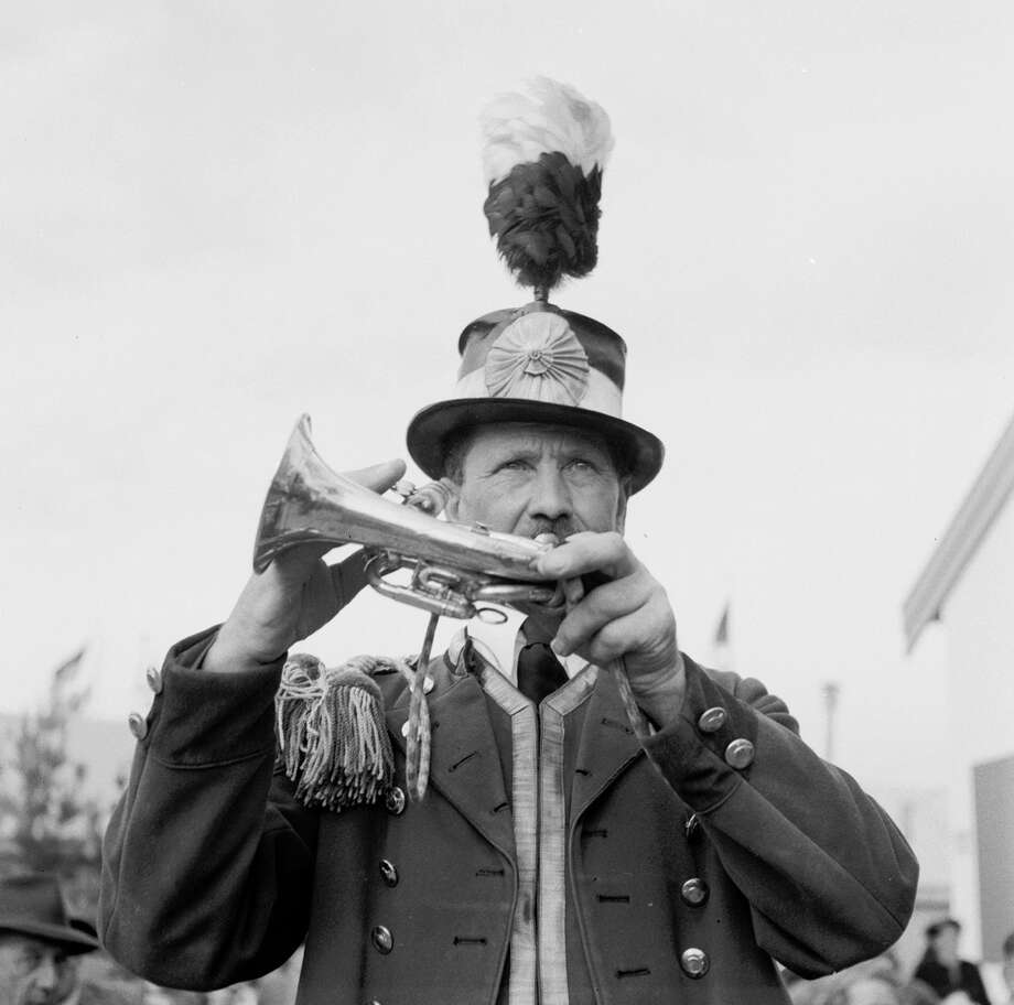 A horn player who specializes in drinking songs, playing his horn at the Munich Oktoberfest, traditionally attired in the musician's plumed hat and epaulette adorned jacket. Photo: Three Lions, Getty Images / Hulton Archive
