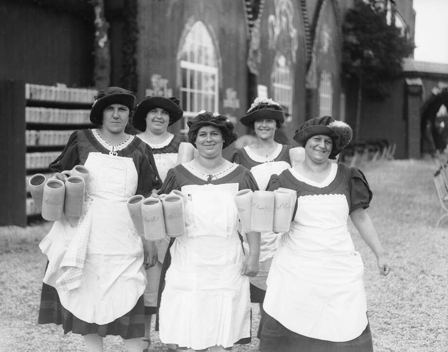 A group of beer maids dressed in costume at the great 'Oktoberfest' in Munich, Germany. Photo: Fox Photos, Getty Images / Hulton Archive