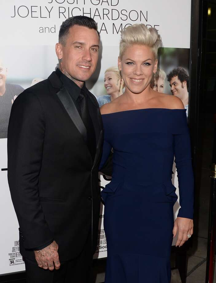 Professional motorcycle racer Carey Hart (L) and Pink attend the premiere of Roadside Attractions' 'Thanks For Sharing' at ArcLight Cinemas on September 16, 2013 in Hollywood, California.  (Photo by Jason Merritt/Getty Images) Photo: Jason Merritt, Getty Images