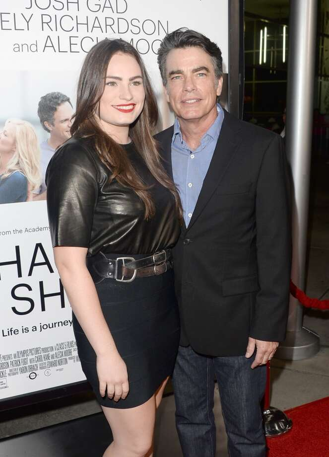 "Actor Peter Gallagher (R) and daughter, singer Kathryn Gallagher, attend the premiere of Roadside Attractions' ""Thanks For Sharing"" at ArcLight Cinemas on September 16, 2013 in Hollywood, California.  (Photo by Jason Merritt/Getty Images) Photo: Jason Merritt, Getty Images"