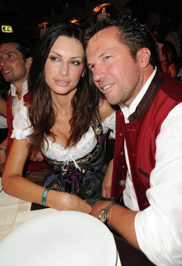 Lothar Matthaeus and Joanna Tuczynska attend attend the Oktoberfest beer festival at Kaefer Schaenke beer tent on Sept. 17, 2011 in Munich, Germany. Photo: Hannes Magerstaedt, Getty Images / 2011 Getty Images