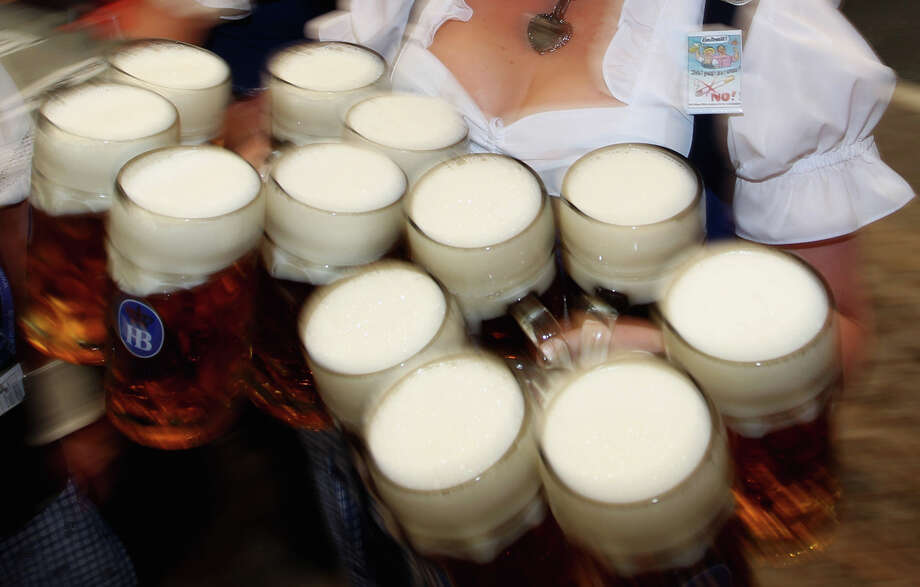 A waitress carries beer mugs during the opening day of the Oktoberfest 2011 beer festival. Photo: Alexandra Beier, Getty Images / 2011 Getty Images