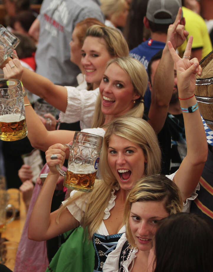 Women celebrate with beer mugs during the opening day of the Oktoberfest 2011 beer festival. Photo: Alexandra Beier, Getty Images / 2011 Getty Images