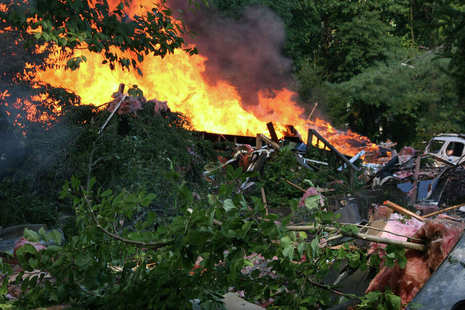 An explosion leveled a house at 305 Webbs Hill Road in North Stamford Tuesday afternoon. Photo: Bill Tenca