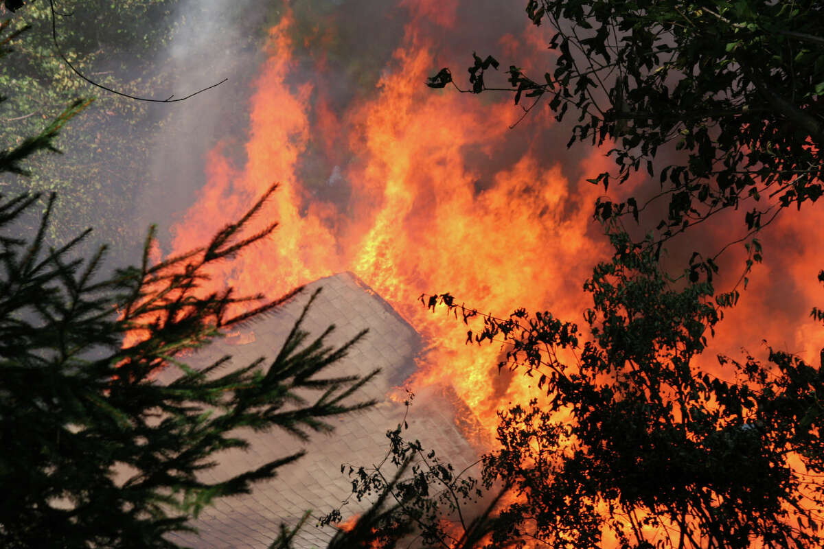 A massive blaze burns after a 500-gallon underground propane tank exploded destroying a home at 305 Webbs Hill Road in North Stamford on Sept. 12, 2013.