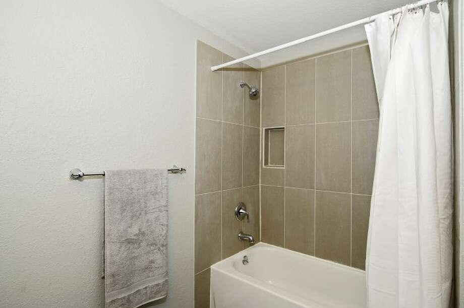 Bathroom of 7954 39th Ave. S. It's listed for $399,000. Photo: Courtesy Anne Marie Peterson, Windermere Real Estate