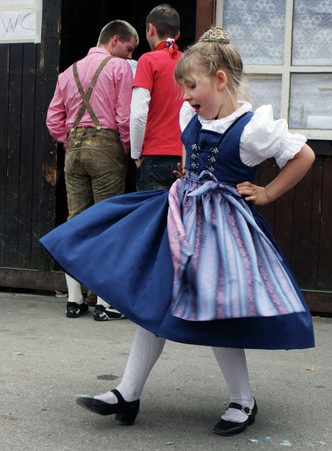 A young girl pictured in a traditional German dirndl dances during Oktoberfest. Photo: Chad Buchanan, Getty Images / 2008 Chad Buchanan