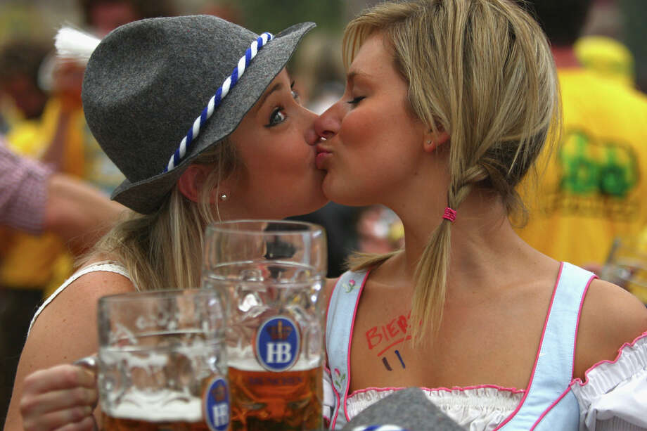 Festival visitors raise their beer glasses after the opening of the Oktoberfest beer festival on Sept. 20, 2008. Photo: Andreas Rentz, Getty Images / 2008 Getty Images
