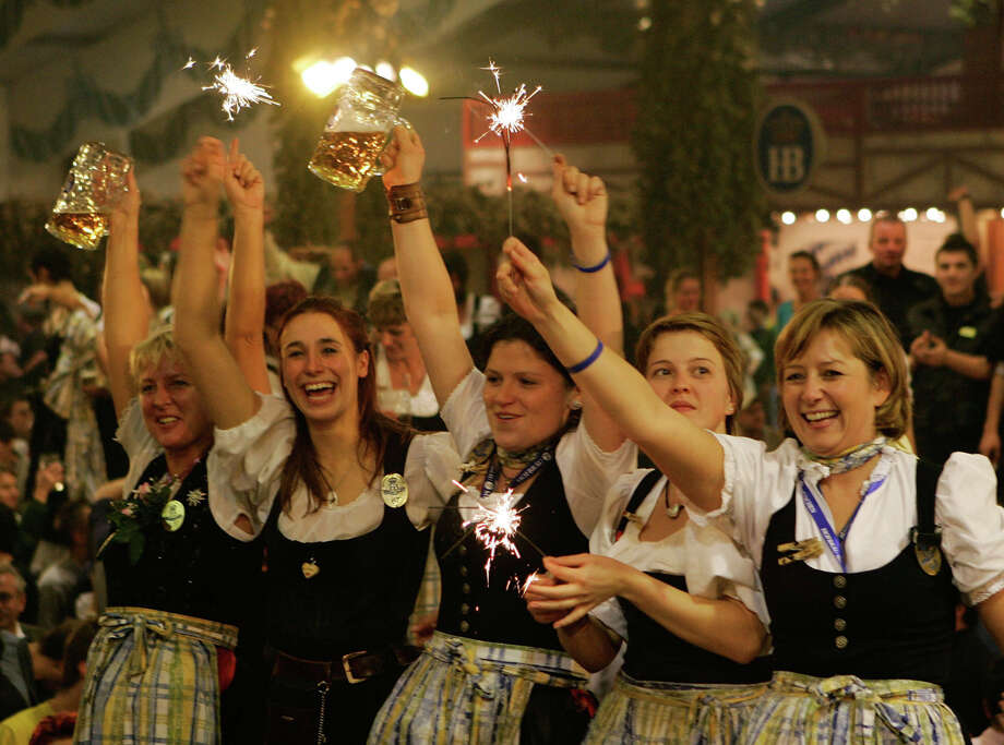 Waitresses stand on a table as they celebrate Oktoberfest in a beer tent Oct. 3, 2005 in Munich, Germany. Photo: Jan Pitman, Getty Images / 2005 Getty Images