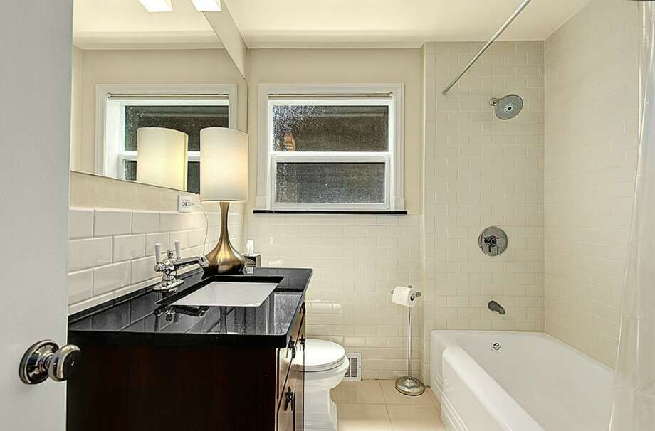 Bathroom of 2601 S. Ferdinand St. It's listed for $419,950, although a sale is pending. Photo: HD Estates, Courtesy Peggy Smith, Lake & Co. Real Estate