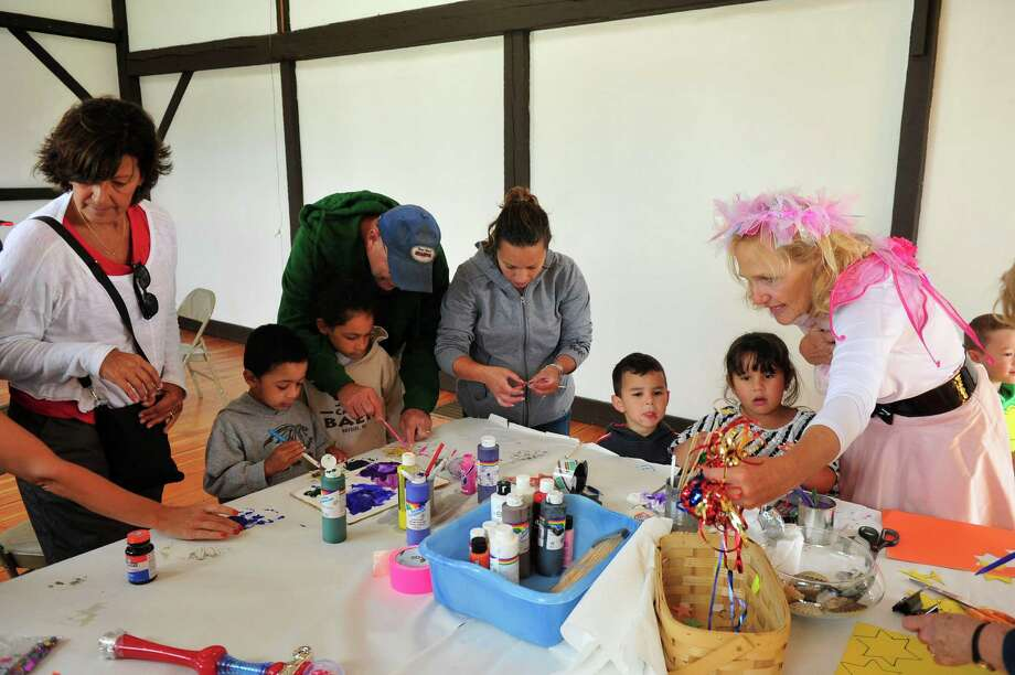 """Author Jane Collins, creator of the Enjella series about a tooth fairy turned """"Elbow Fairy,"""" presents an interactive program for kids at Tilly Foster Farm, in Brewster, N.Y. Saturday, Sept. 14, 2013. Photo: Michael Duffy / The News-Times"""