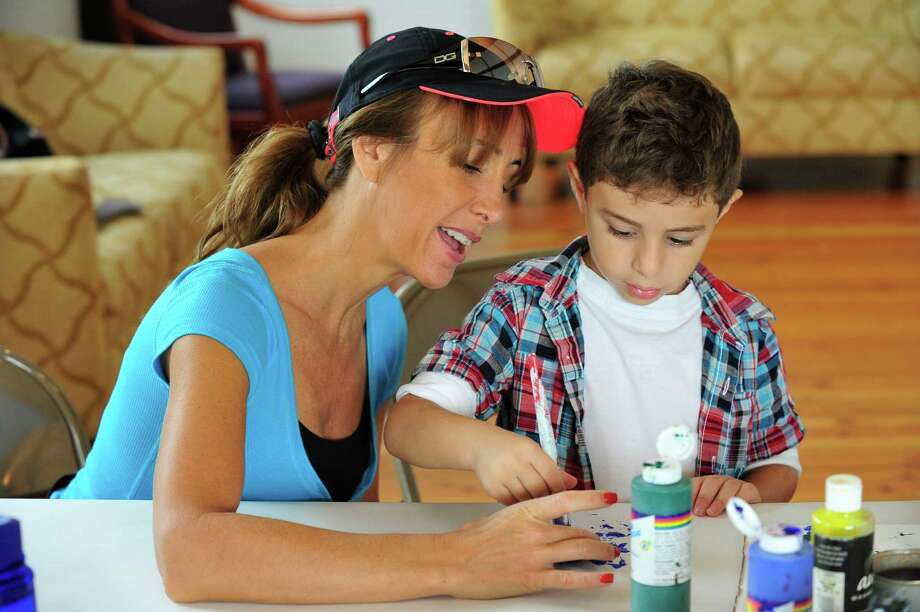 "Author Jane Collins, creator of the Enjella series about a tooth fairy turned ""Elbow Fairy,"" presents an interactive program for kids at Tilly Foster Farm, in Brewster, N.Y. Saturday, Sept. 14, 2013. Photo: Michael Duffy / The News-Times"